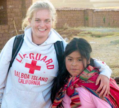 NLC alumna Tori Raine and a friend in Peru