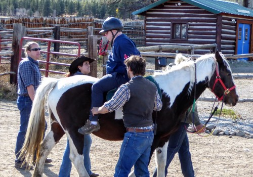 Riding backwards on a horse, like this RVRN participant, is a significant exercise in trust that takes place at 100 Elk.